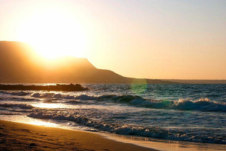 Malia Beach at sunset in Crete, Greece