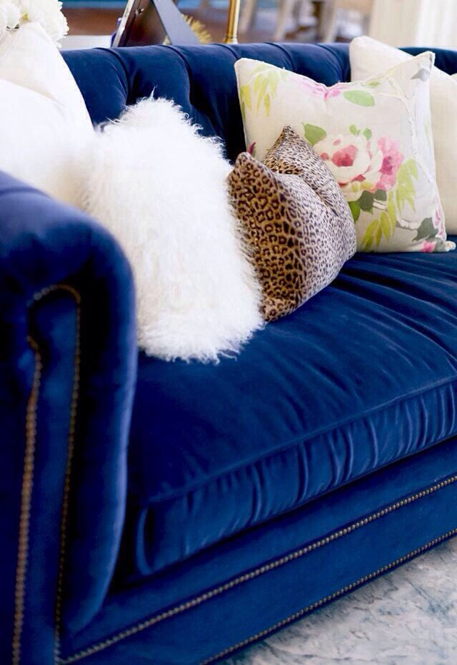 Ooh I LOVE this blue velvet couch and fluffy white cushion!!
