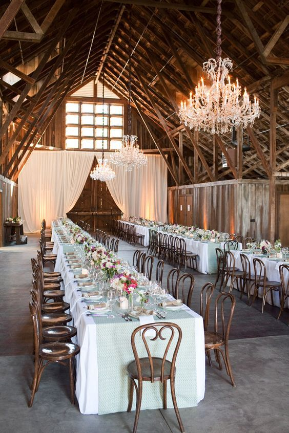 rustic barn venue is spectacular, with dramatic large doors / http://www.himisspuff.com/rustic-indoor-barn-wedding-reception-ideas/8/