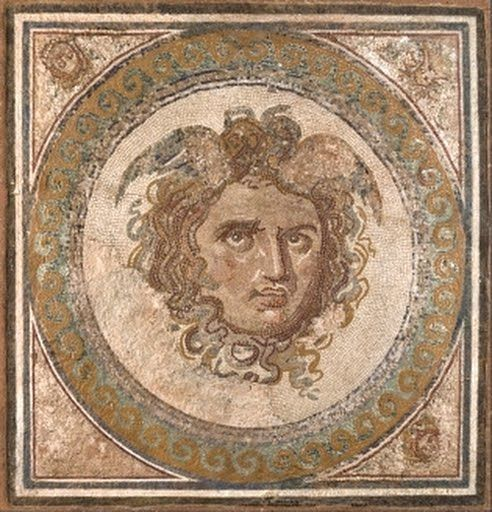 The central emblem of a floor mosaic inspired by the myth of Perseus that depicts the head of the Medusa. The preserved part was laid in situ by an expert ...