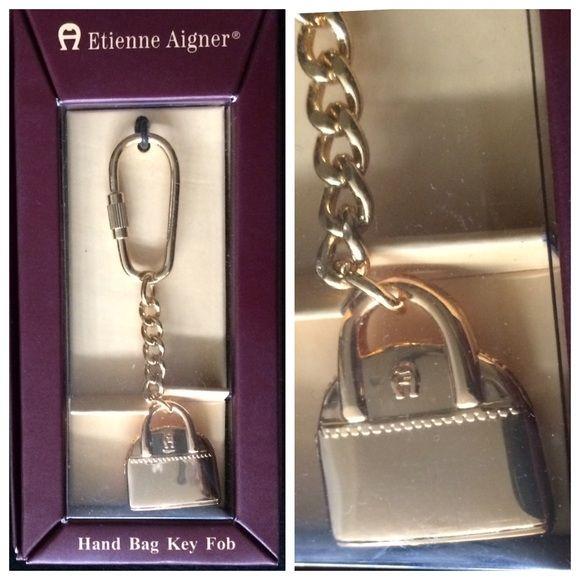 Etienne Aigner handbag key ring Entiene Aigner gold tone handbag charm keyring. Never used. In the original box. Etienne Aigner Accessories Key & Card Holders