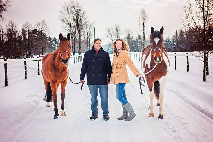 Winter engagement photo with the horses! Photo credit EDGE Photography.