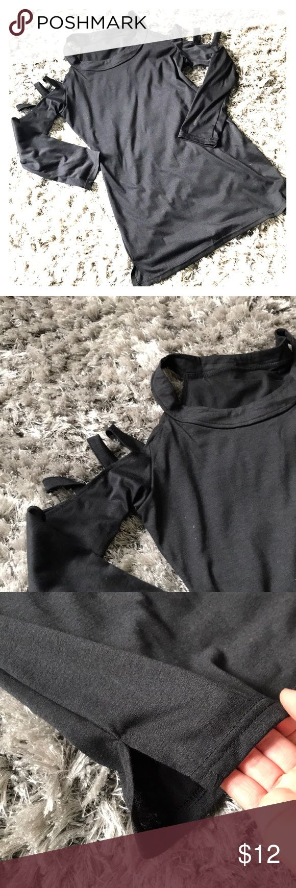 Black tunic NWOT Sext cut out sleeves. Thinner t-shirt like material. This is a size Large but  Runs small .  I'm a small  and this is just a bit big on me. However, if you want wear it looser & you're well endowed, then this would fit you well. I would not recommend this tunic if you wear a size large  . Gifted to me , & never worn . Tops Tunics