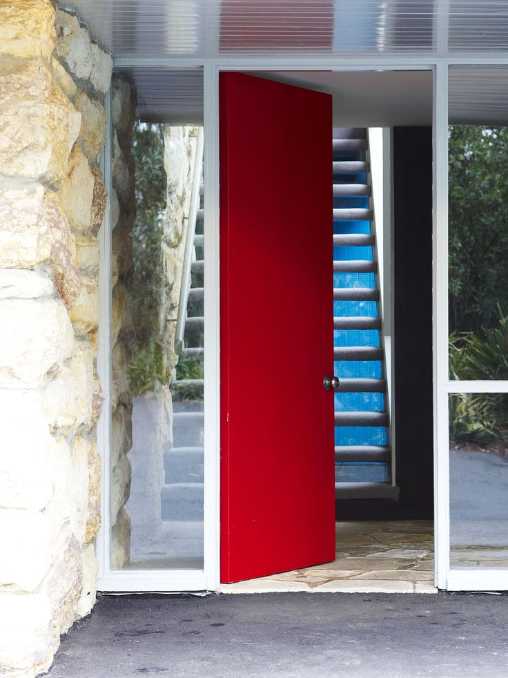 Red front door opening to entrance lobby at bottom of stairs at Rose Seidler House.  Repinned by Secret Design Studio, Melbourne. www.secretdesignstudio.com
