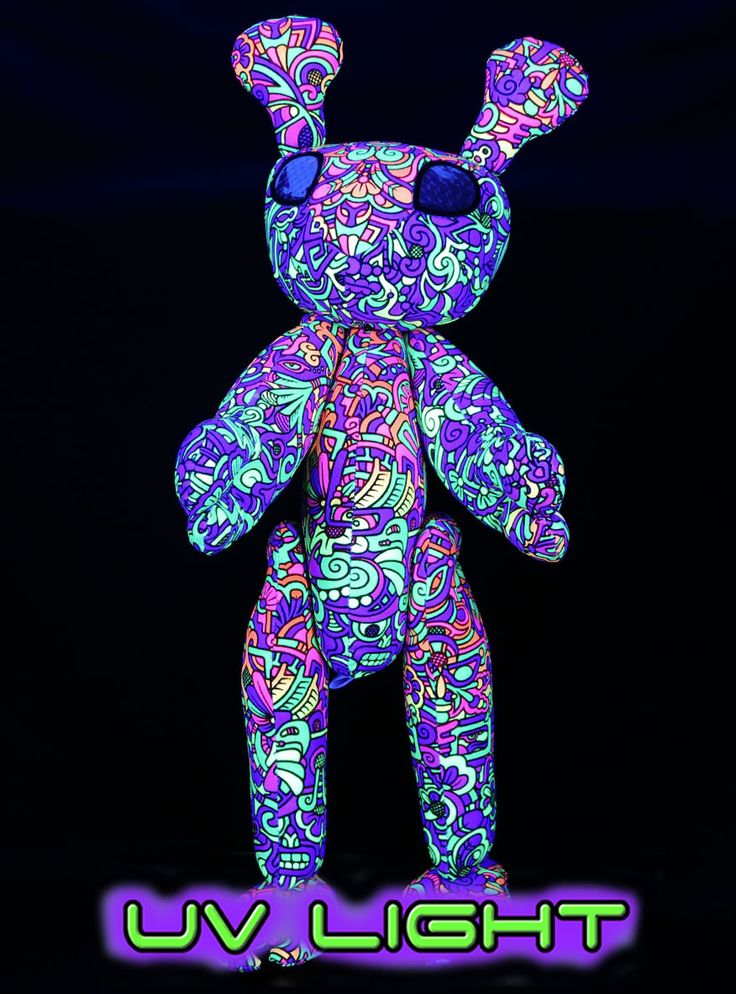 Space Tribe Alien !  Approximately 40 cm tall.  UV Active !  Movable arms & legs. Holographic plastic eyes.  100% cotton with Dacron filling.  Please note, The alien's pattern & colours can vary a bit, depending on which part of the fabric is used.