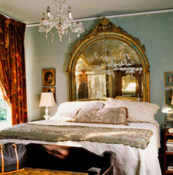 Beautiful.....I never thought of using a mirror as a headboard. I think I like this idea.