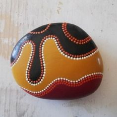 painted rock-three colors, lines edged with dots of contrasting