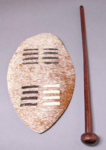 A Zulu knobkerrie together with a later Zulu dance shield fight and protect