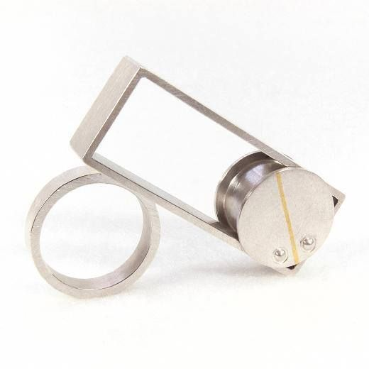 Fine Line rolling ring: Large rolling ring in sterling silver, inlaid with fine gold. Sophie Stamp