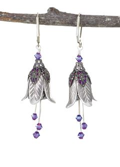 Silver Flower Earrings:  The enticing bloom of a dangling flower, luring hummingbird and bee. Leaves of fine filigree over purple enamel open to silver petals in full bloom. Silver stamens sparkle with lavender crystals for further allure. Latchback earhooks. Made in USA.