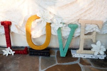 yarn covered letter decor in wedding colors for reception