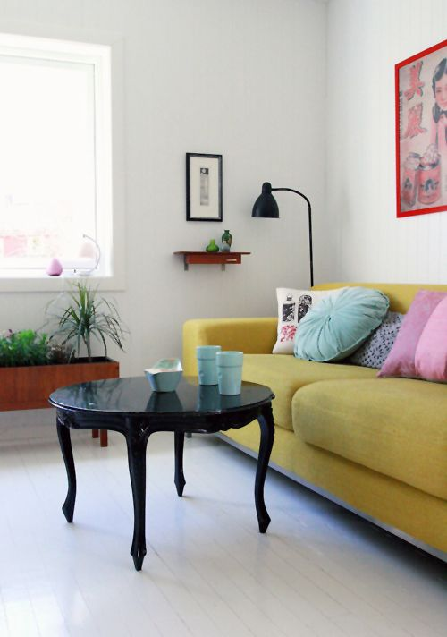 Love the juxtaposition of the contemporary sofa and the traditional table