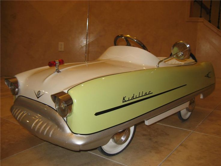 """Adorable 1950's Garton Kidillac """"Cadillac"""" pedal car with chain drive.  Well documented, professionally restored to Concours standards.  Complimented with Co..."""