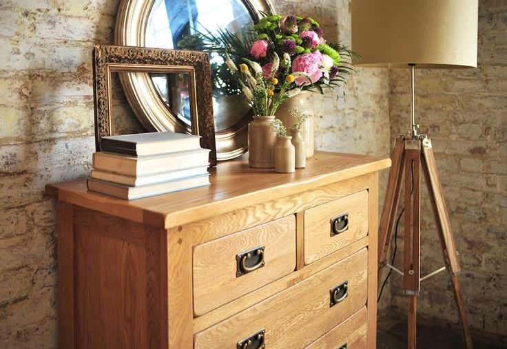 Oak bedroom, Oak chest of drawers, dream bedroom, brick walls, antique gold frame, round mirror, tripod lamp, blue books, roses, craspedia, veronica, vintage jug.
