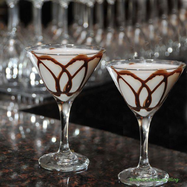 White Chocolate Martini       (2 ounces white chocolate liqueur    2 ounces Baily's      2 ounces Vanilla vodka    1 ounce créme de cocoa    Chocolate syrup)