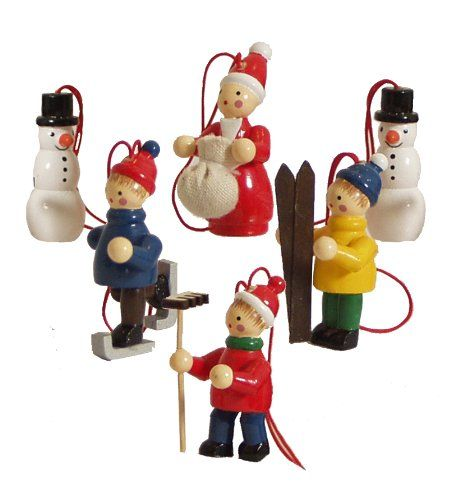 Add some Wooden Christmas Decorations to your decor this year. There is nothing like the feel of wooden decorations that have been painted with bright colors.