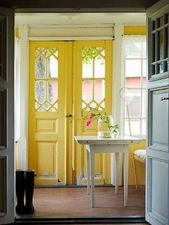 french doors in bright yellow. lake house.