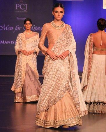 Manish Malhotra 2014: Peach silk Lengha teamed with a peach silk blouse along with an ivory chikankari dupatta & a cancan