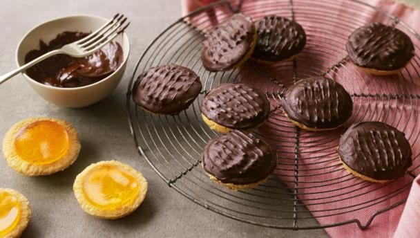 Jaffa cakes are no where near as tricky to make at home as you might think. The only fiddly bit is making the chocolate look perfect – but they're still great if you just spoon it over.  For this recipe you will need a 5cm/2in round biscuit cutter, a 30x20cm/12x8in baking tray and a 12-hole shallow bun tin.