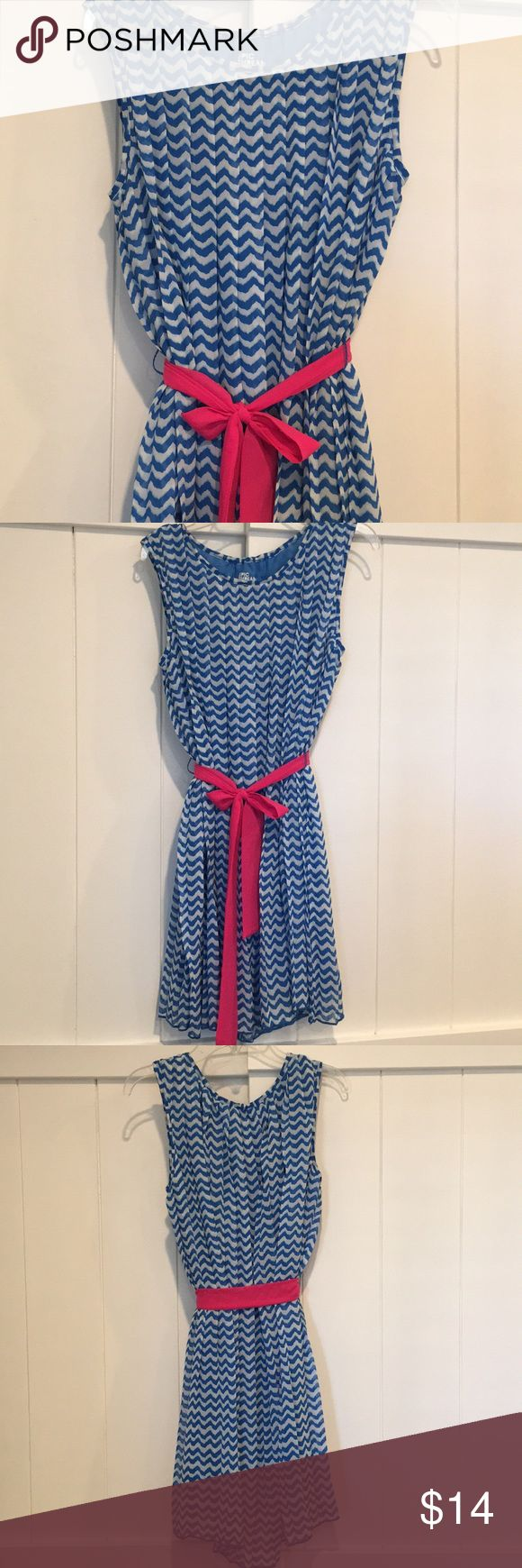 Girls Blue Chevron Dress with Pink Sash Barely used dress in excellent condition! Pleated around the neckline and carries down through the bottom of the dress. The bright pink sash can be worn in front, back, side or you can remove it altogether. Built in slip. Length is approx 32 inches from top to bottom. Epic Threads Dresses