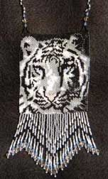 White Tiger at Sova-Enterprises.com This was my first animal in my wildlife series. Makes a great necklace or amulet. Full color graph with symbols. Bead color chart and photo of finished item included. Thank you  Project Type: Bead Stitch: peyote/brick Beads Used: seed Approx Finished Size: 4 x 4 inches Pages To Print: 3