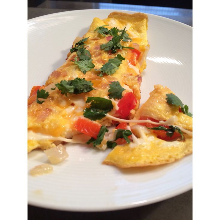 Omelette's are a great way to start your day with protein and vegetables. They are simple to make and you can be creative with your ingredients! This morning I sautéed red onion, red pepper and yellow pepper in coconut oil, then poured 2 beaten organic eggs over the veg. Let cook for a few minutes over medium heat and then fold one side over, sprinkle a little cheese and fold over the remaining side...