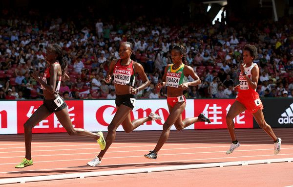 Genzebe Dibaba Photos Photos - Mercy Cherono of Kenya (2nd L) and Genzebe Dibaba of Ethiopia (2nd R) compete in the Women's 5000 metres heats during day six of the 15th IAAF World Athletics Championships Beijing 2015 at Beijing National Stadium on August 27, 2015 in Beijing, China. - 15th IAAF World Athletics Championships Beijing 2015 - Day Six