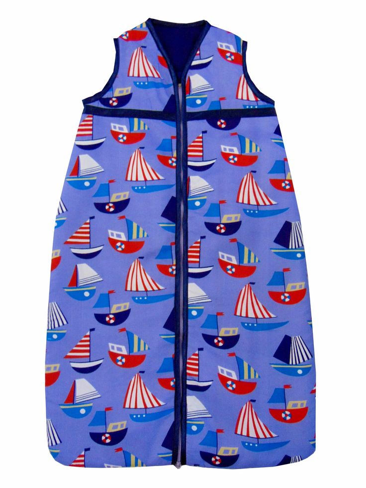 Very cute sail boats design baby sleeping bag. Sizes 0-36 months. Satin trim to arms, neck and zip edge. Two layers of soft cotton with cosy inner batting. Central zip from bottom to top for ease of changing.