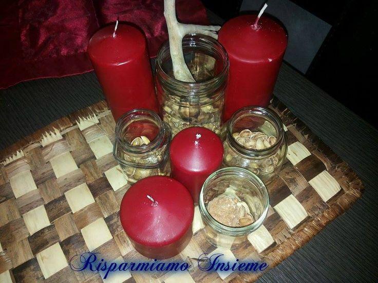 candele, barattoli in vetro e gusci di pistacchio