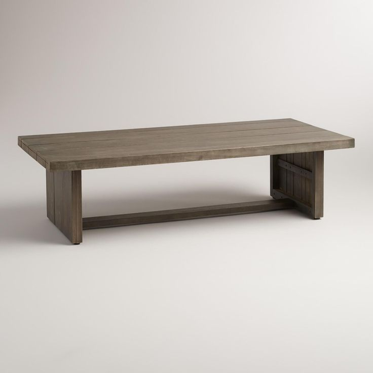 Featuring an extra-chunky silhouette brimming with chic industrial style, our exclusive outdoor coffee table is crafted of solid acacia wood with a distressed gray finish. >> #WorldMarket Outdoor Entertaining & Decor