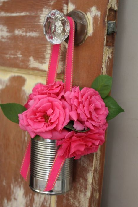 Quick and Easy but totally charming - Hang Tin can from ribbon on doorknob and add flower - Hanging Tin Cans can also be used instead of the ever present canning jars for a lighter application of hanging flowers #DIY