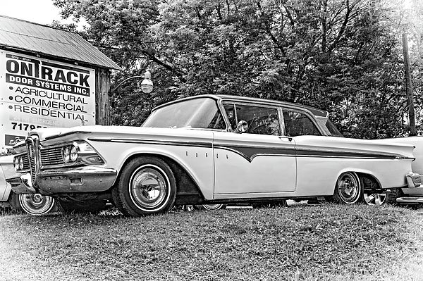 A Valuable Lemon Bw.  The 1958 Edsel became a synonym for failure for many reasons. It was overhyped, overpriced, and strange looking to many. In particular, its unique grill was perceived variously as a horse collar, toilet seat, and even a vaginal symbol. I prefer the latter interpretation and find it a fairly good looking car for its era. Restored beauties like this one in southern Ontario often fetch over $40,000!