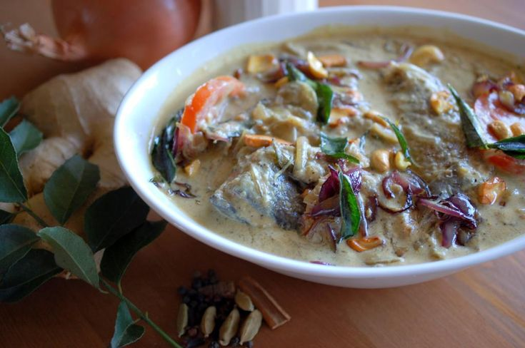 Fish simmered in coconut milk with onion, ginger- garlic, pepper and tomatoes.