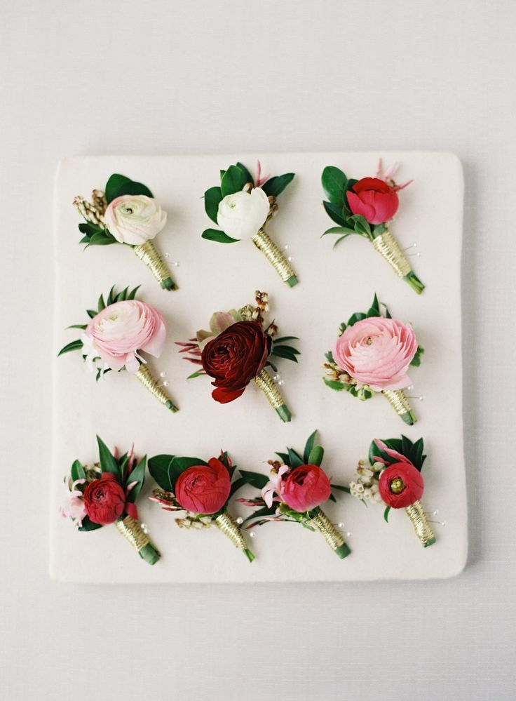Blush, peach and red ranunculus boutonnieres: