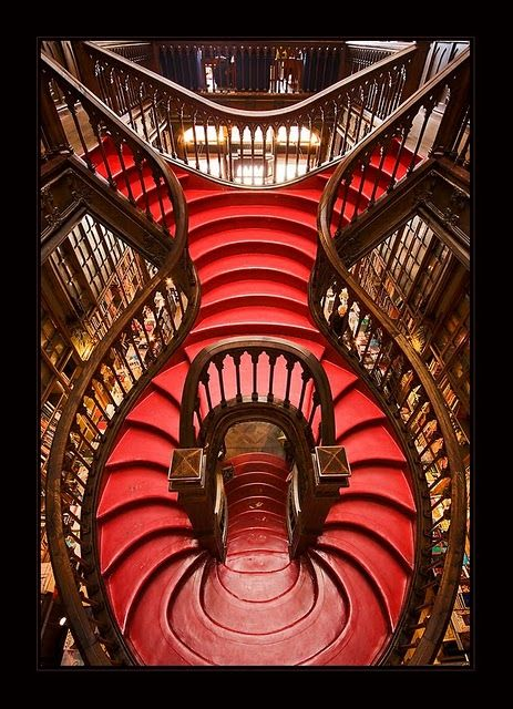 An amazing and ornate staircase in the Livraria Lello, located in Porto Portugal. Commissioned by Jose Pinto de Sousa Lello in 1894 and built in 1906 by engineering professor Xavier Esteves.