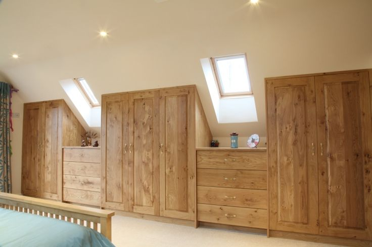 Innovative bedroom design - wardrobes built into the sloped ceiling