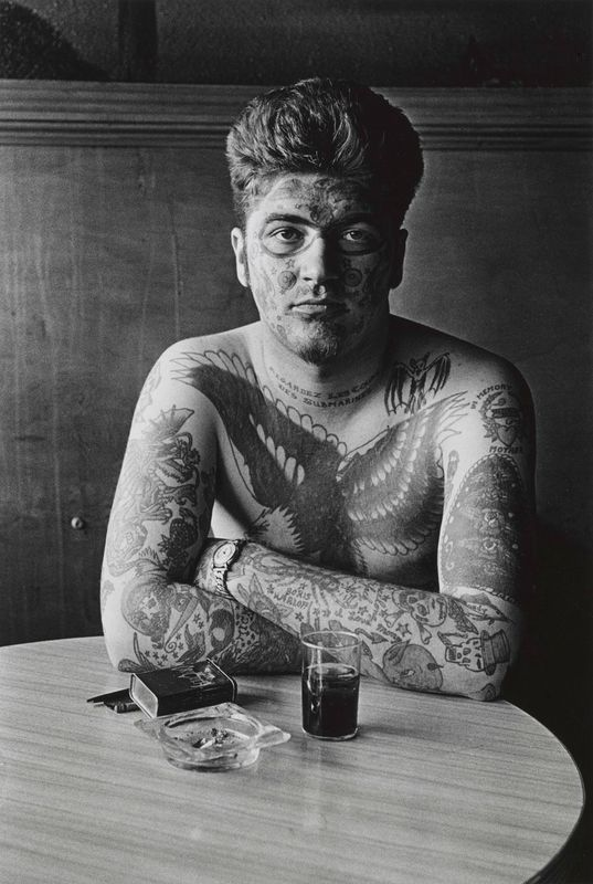 Diane Arbus, Jack Dracula at a bar, New London, Connecticut, 1961; promised gift of Doan Arbus and Amy Arbus, 2007; courtesy The Metropolitan Museum of Art, New York / copyright © The Estate of Diane Arbus, LLC. All rights reserved.