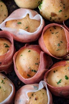 Garlic doughballs wrapped in proscuitto ham