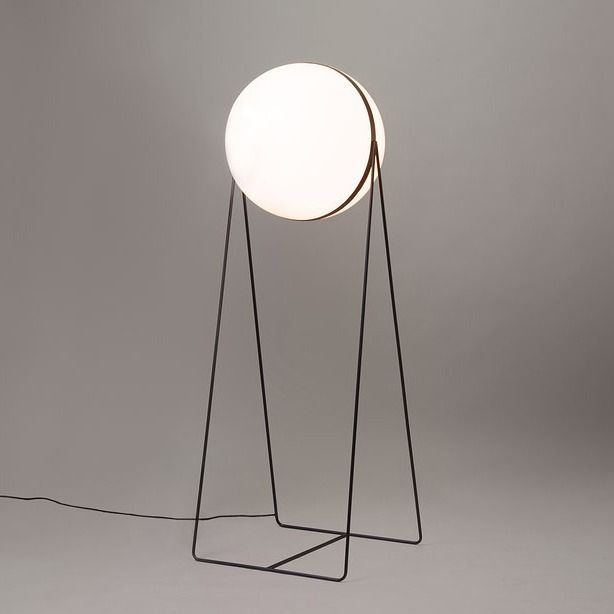 Stevan Djurovic's Luna Lamp is a bold and beautiful statement in lighting. Standing, literally, as a beacon of illumination, it also has its own sculptural presence. This piece sees a minimal powder-coated matte finish metal frame, supporting an almost floating bulb-type piece. The bulb itself is also moveable, and its movement is the method by which the light is switched on (demonstrated here).
