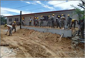 Texas Army National Guard Soldiers from 236th Engineer Company, 111th Engineer Battalion, 176th Engineer Brigade installed approximately 330 linear feet of chain-link fence, along with gates located at the back of the building and roadway entrance near Zacapa, Guatemala, May 17-31, 2014. The soldiers provided much-needed engineering improvements to area schools as part of Beyond the Horizon 2014. (U.S. Army National Guard Photo Courtesy of 236th Engineer Company/Released)