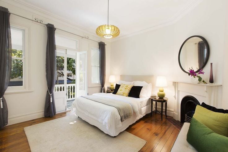Polished timber floors and period features in this master bedroom at 18 Boundary Street, Paddington