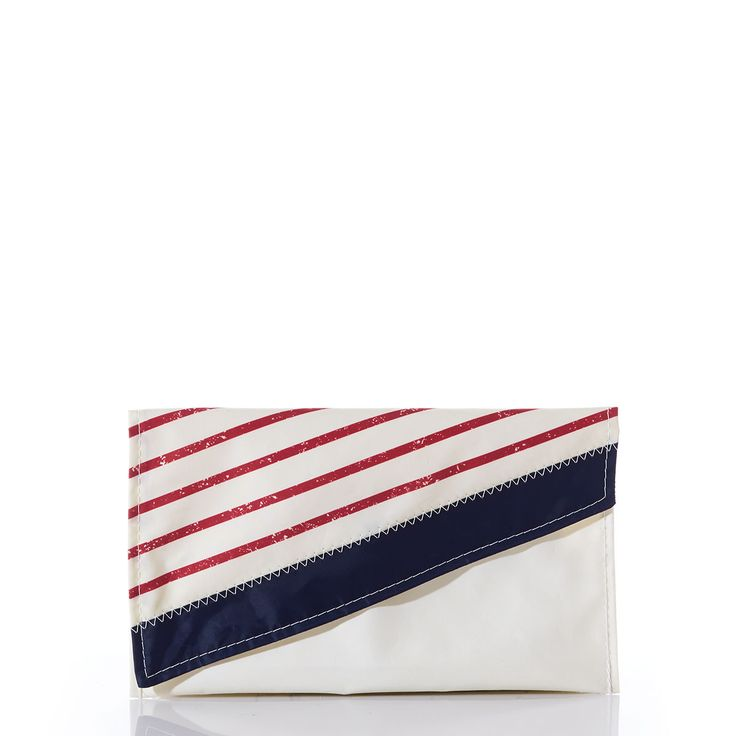 RED MARINER STRIPE CLUTCH! This chic-shape clutch adorned with Breton stripes adds a summery flair to jeans and a tee or a classic accent to a sundress. It's small and sleek—just the right size to hold a phone, cards, keys and lipstick. It's a grab-and-go lifesaver when you need to dash out to pick up kids or meet friends for dinner!