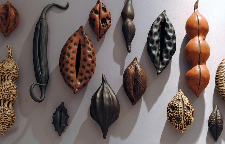 Assorted pod sculptures by Janis Hughes  www.evolutionstoneware.com  www.facebook.com/evolutionstoneware