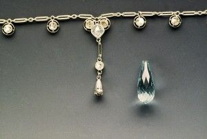 Before restoration of the aquamarine pendant. From http://cranejewelers.com/