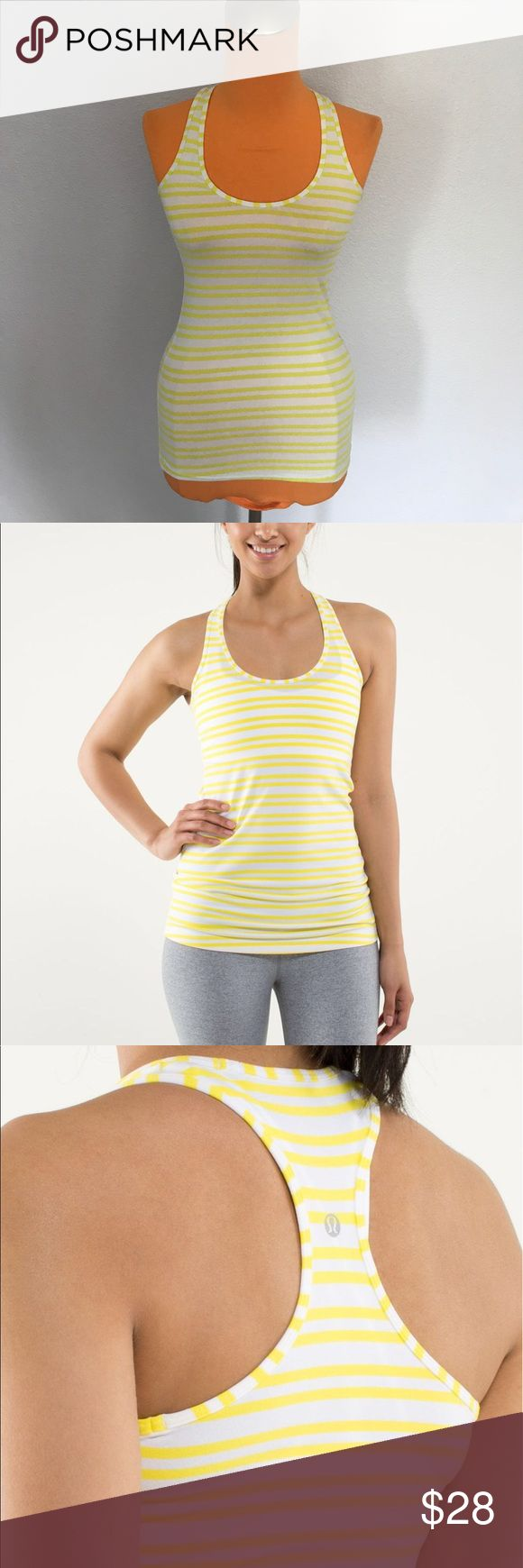 """Lululemon Twin Stripe Sizzle Cool Racerback 26"""" length 12.5"""" armpit to armpit. Designed for training, yoga or running. Sits right against your body. Twin Stripe sizzle pattern. Which is a white tank with yellow stripe. Size tag off but see measurements, is between 2/4. Cool Racerback. Has small faint mark on backside otherwise excellent condition. Bundle 2+ items for a discount. lululemon athletica Tops Tank Tops"""