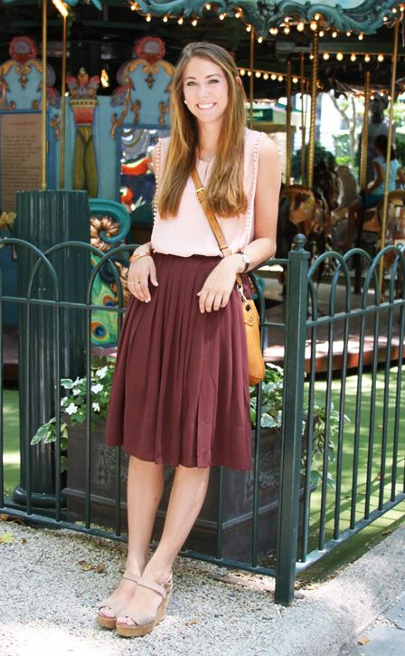 mid-length skirt & tucked in sleeveless blouse