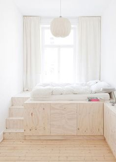 Child's Bedroom with Elevated Plywood Bed and Paper Lantern - love idea of a lofted bed with storage underneath!