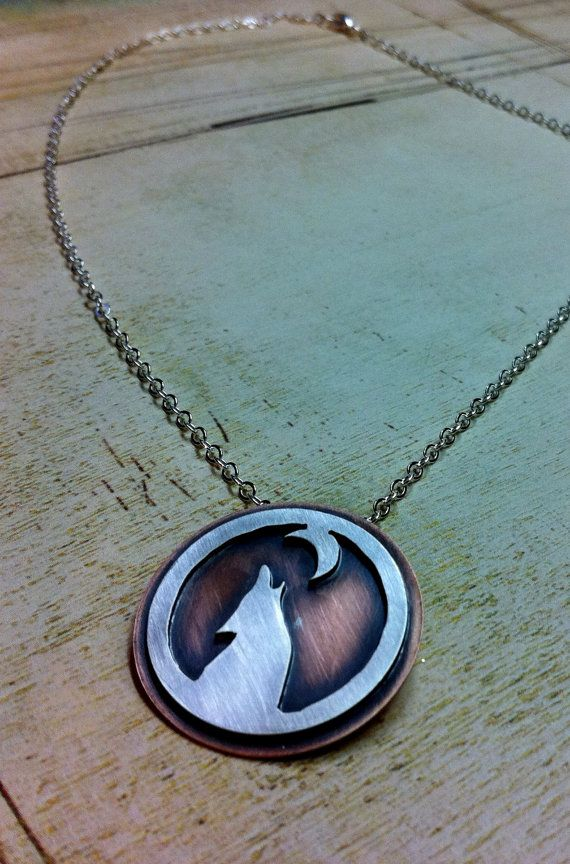 Lone Wolf. Sterling Wolf Necklace. Mixed Metal Jewelry. Copper and Silver Wolf and Moon. Wolf Pendant.. $55.00, via Etsy.