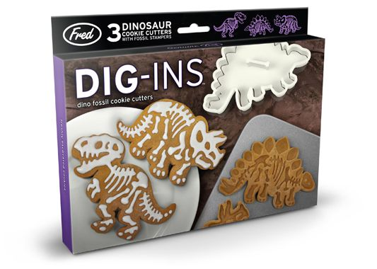 Fred  Friends - DIG INS Cookie Cutters. Dino fossil cookie cutters. Look what Fred's dug up - Dig-Ins are prehistoric party perfection! You can punch crisp cookie outlines with the cutter, then emboss perfect skeletal remains with the stamper. We've included three detailed dinos in each set. You'll make cookies good enough for a natural history museum...or a cookie jar!
