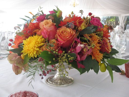Red Floral Centerpiece with dahlias, roses, orchids, apples and mums